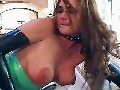 Brunette fucks in latex lingerie boots and gloves