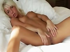 Blonde babe spreads pink pussy