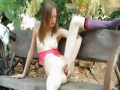 Ultra skinny teenie fingering on a bench
