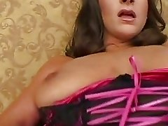 Seductive busty brunette in sexy lace lingerie strips and teases