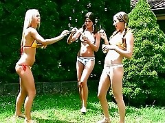 Three skinny teens in bikinis licking and fingering outdoor
