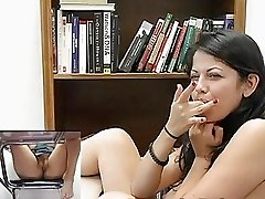 Busty brunette chick fingers her cunt in the library