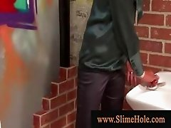 Glory hole skanks sucks cock in male bathroom