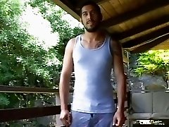 Bearded gay hunk strips his clothes outdoors