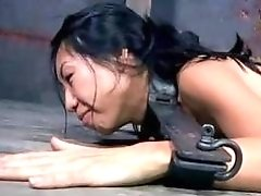 Bound Asian slave girl loves being ass toyed BDSM porn