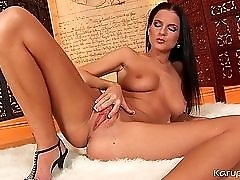 Leggy Euro brunette with a perfect tan plays with her pussy