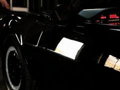 Jayden Cole plays inside the Knight Rider car
