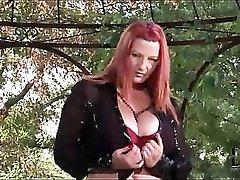 Curvy redhead in a slutty latex skirt