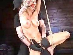 Athletic bound bitch destroyed by a fuck machine BDSM porn