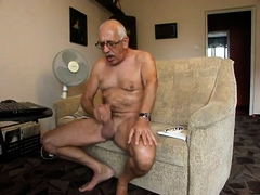 Horny old man with glasses feeds his lust for masturbation
