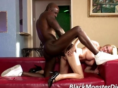 Busty MILF massages a Black Cock