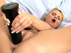 Large Black Dildo into her kitty