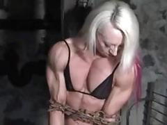 Muscled bodybuilder woman chained up for own safety BDSM porn