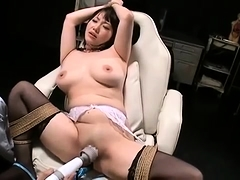Busty Asian beauty is made to reach her climax with sex toys