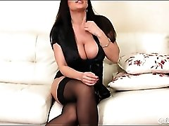 Lisa Ann in lace lingerie and black stockings