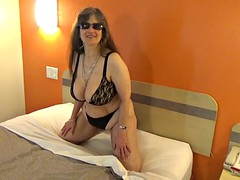 tinja heats up the room in a black lace bra and panty set