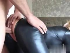 Leather clad blonde sucking dick and getting boned