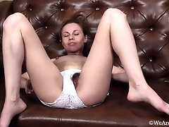 Liliya masturbates after listing to music on couch