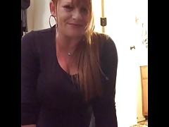 Mature ginger rides her toy