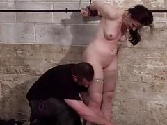 Bondage slave Caroline Pierce dungeon whipping of