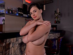 Dazzling teases with her hot body in kitchen
