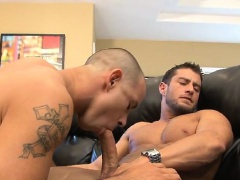 He takes Cody's hardon into his mouth, sucking the hunk dry.