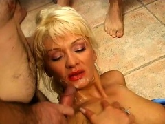 Buxom blonde milf has a group of guys cumming on her face