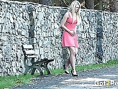 Beautiful blonde in a pretty dress pees in public