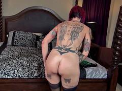 Heavily tattooed redhead babe sucks a dick like a pro