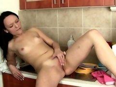 Frisky Brunette Rubs Her Shaved Pussy Vigorously