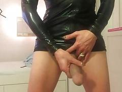 Latex German shemale jerks off her big cock on picture-frame
