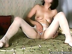 She masturbates in white fishnet pantyhose