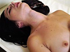 Yummy brunette doll plays with her shaved pussy in bed