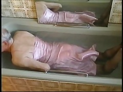 in the tub this time wearing a full length nylon nightdress.