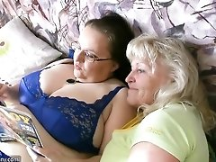 Two old Grannies and big tits have fun and strip in bed