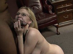 passionate blonde in glasses delivering a doting handjob