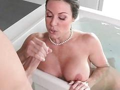 Stepson sneaks on her stepmom in the tub