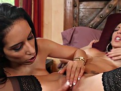 two lesbian babes plays in a passionate lesbian games on the bed