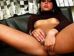 Arousing brunette is really horny while jerking off and moaning