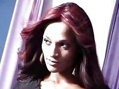 Ravishing redhead tranny poses for the camera on the set