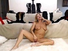 Busty blonde cougar sucks a cock and masturbates on webcam