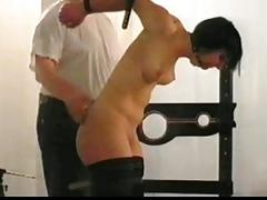Helpless brunette gets gagged on the bondage device BDSM porn