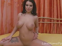 Tattooed girlfriend displays her tits and pleasures herself