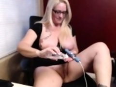 Huge breasted blonde cougar takes her peach to pleasure on