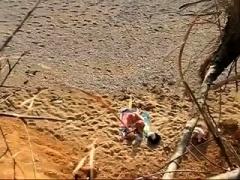 Beach voyeur shoots a horny mature couple having hot sex
