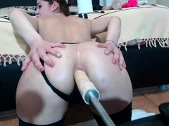 Hot girl in stockings has a mechanical toy plowing her ass