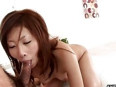 Asian redhead slams her hairy cunt on a hard schlo