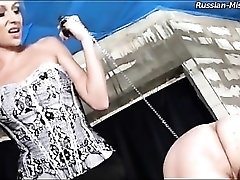 Naked guy spanked on the ass by a beauty