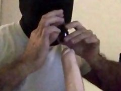 Hooded deepthroats a dildo