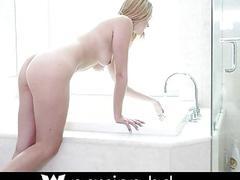 Hot blonde teen takes a bath